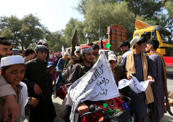 Taliban ride on a motorbike as they celebrate ceasefire in Bati Kot district of Nangarhar province, Afghanistan