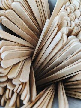 Wooden stir sticks in a swirl
