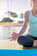 Cropped picture of woman on the water in yoga meditation