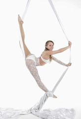 Printed roller blinds Gymnastics Pretty woman hanging in aerial silk - aerialist performing aerial tricks.