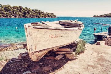 Fishing boat with cracked white paint, Solta island, red filter