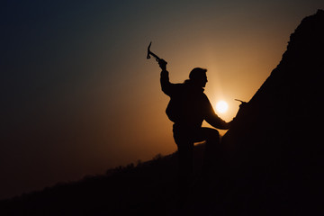 alpinist at sunset