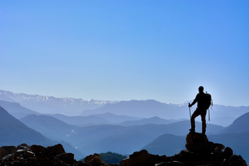 successful people at the height of desolate and fascinating mountains