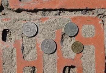 Money on bricks