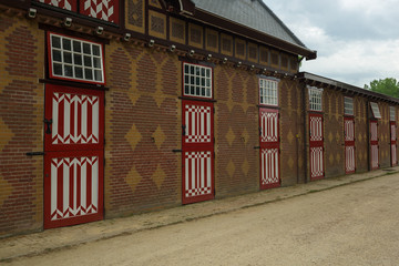 Red and white decorated doors of the stables of De Haar Castle