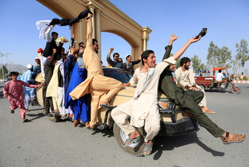 People celebrate ceasefire in Rodat district of Nangarhar province, Afghanistan