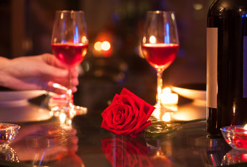 Romantic candlelight dinner restaurant setting.  Valentines Day, and date night concept.