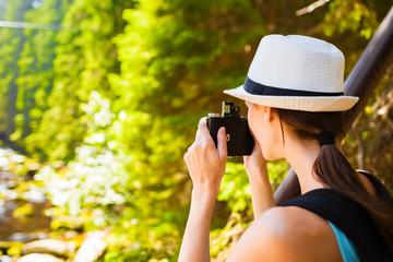Nature photographer taking photo.