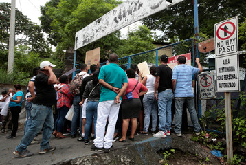 People stand outside a jail demanding that family members who had been detained during recent protests be released, in Managua