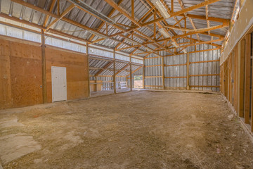 Interior of empty barn with wooden beams