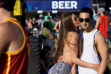 A couple kisses on the third day of the Firefly Music Festival in Dover, Delaware U.S.