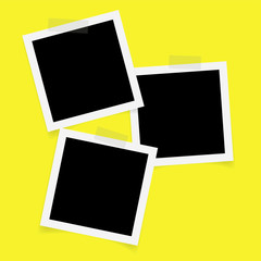 Three square photo frames with sticky tape on yellow background.