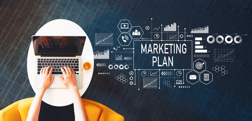 Marketing Plan with person using a laptop on a white table