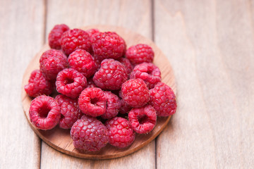 Raspberries on a wooden cutting board