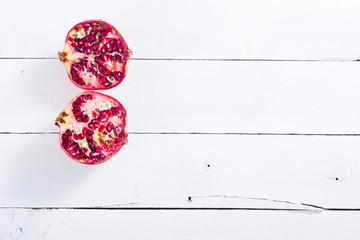 pomegranates on white wood table background
