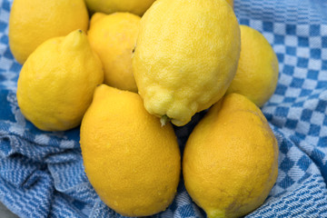 yellow lemons with blue towel