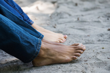 bare feet on a sandy beach
