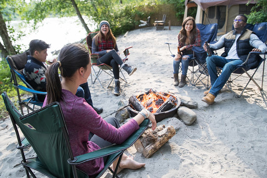 Group of friends camping outside in nature
