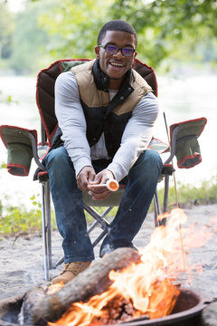 Roasting marshmallow at campfire