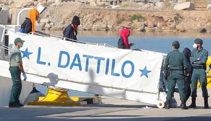 Refugees disembark the Dattilo Italian coast guard ship in the port in Valencia