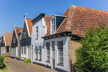 Old houses in Oudeschild on Texel island, The Netherlands Wall mural