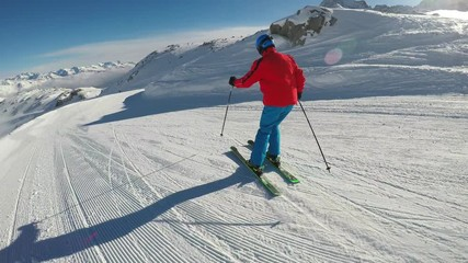 Fototapete - Man skiing on the prepared slope with fresh new powder snow in Rhaetian Alps , Adamello, Tonale, Italy