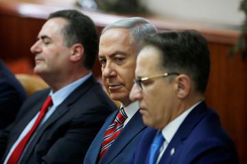 Israeli Prime Minister Benjamin Netanyahu sits next to Israeli Cabinet Secretary Tzachi Braverman and Israeli Intelligence and Transportation Minister Israel Katz at the start of the weekly cabinet meeting at the prime minister's office in Jerusalem