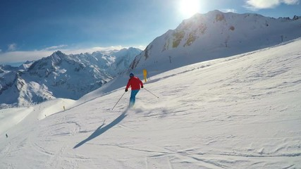 Fototapete - Man skiing on the prepared slope with fresh new powder snow in Rhaetian Alps
