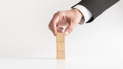 Businessman hand and wooden blocks