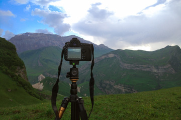 Camera on a tripod, shooting mountains scenery, mobile photo