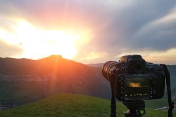 Camera on a tripod, shooting mountains scenery, mobile photo