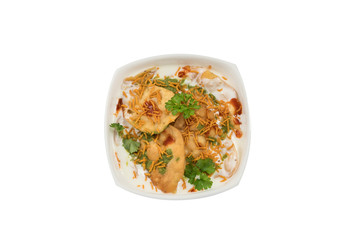Traditional indian street food papdi chaat in white bowl isolated from background
