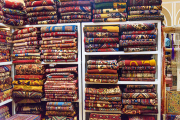Heap of carpets on shop in Yazd. Iran