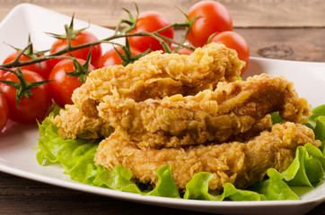 Golden fried chicken strips in breading