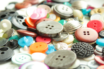 Buttons of different size and color. Close-up. Background. Texture.