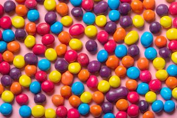 beautiful colorful glaze chocolate sprinkles like background, festive concept