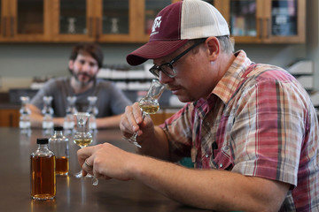 Man senses whiskey varieties at Firestone & Robertson in Forth Worth, Texas,