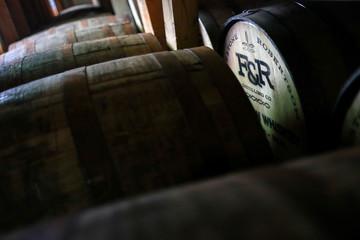 Barrels full of whiskey rest inside barrel barn at  Firestone & Robertson in Forth Worth, Texas