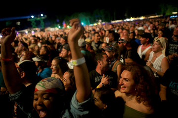 (R) Katerina Bezhani, 21, dances as Eminem performs on the third day of the Firefly Music Festival in Dover, Delaware