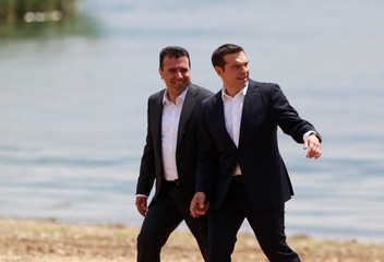 Macedonian PM Zaev and Greek PM Tsipras after the signing of an accord to settle a long dispute over name of the Republic of Macedonia, in the village of Otesevo