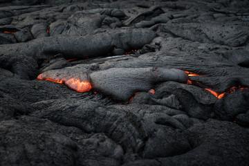 Red, molten, glowing lava flow near Hawaii's Kilauea volcano
