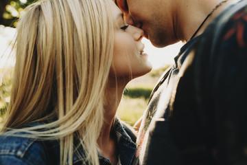 Crop loving couple kissing