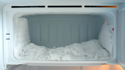 Ice buildup in an empty refrigerator.