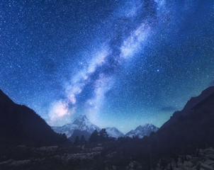 Wall Mural - Milky Way. Amazing scene with himalayan mountains and starry sky at night in Nepal. High rocks with snowy peak and sky with stars. Beautiful Manaslu, Himalayas. Night landscape with bright milky way