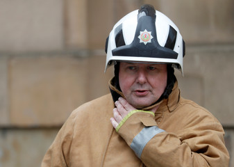 Alasdair Hay, Chief Fire Officer Scotland, visits the scene as firefighters continue to dampen fires in the centre of the city following the blaze at the Mackintosh Building at the Glasgow School of Art in Glasgow