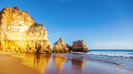 Fototapete - Algarve, Portugal, a stunning sea ocean landscape with yellow rocks and azure water. The beauty of nature and the power of the ocean