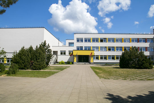 Public school building. Exterior view of school building with playground.