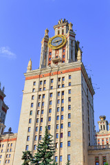 Lomonosov Moscow State University (MSU) tower with thermometer on a blue sky background
