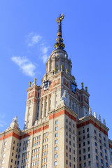 Tower of Lomonosov Moscow State University (MSU) with star on the spire on a blue sky background