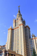 Tower above entrance to Lomonosov Moscow State University (MSU) on a blue sky background